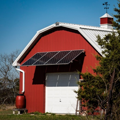Solar panels and rain barrels help with eco friendly operation of the farm.